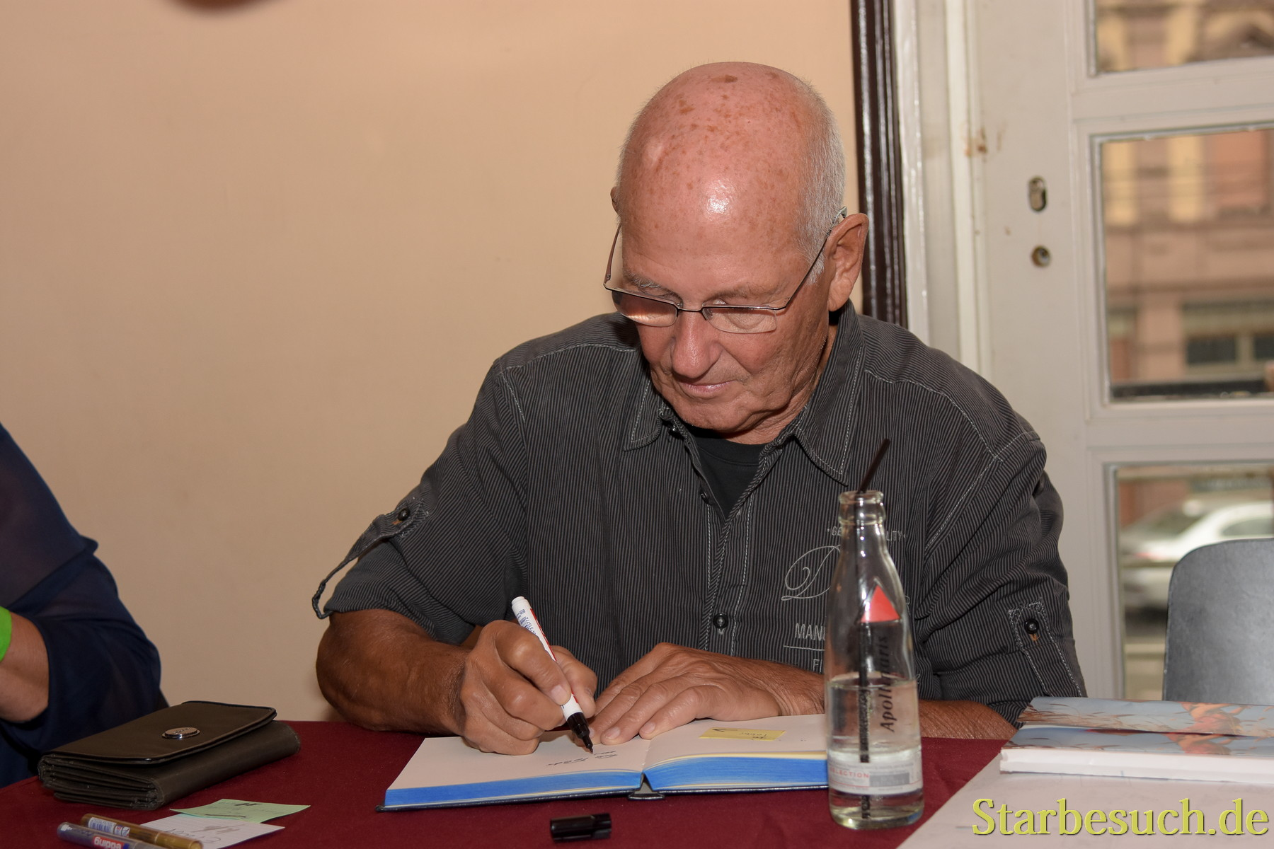 September 2nd, 2017. Mannheim, Germany. Ernst Meincke, german voice of Captain Picard in Star Trek: TNG, signing for fans at Startopia.´Star Trek Actors and Trekkies got together at this convention in Mannheim, Germany
