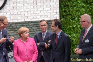 Angela Merkel bei Opel, Matthias Wissmann (Mitte)