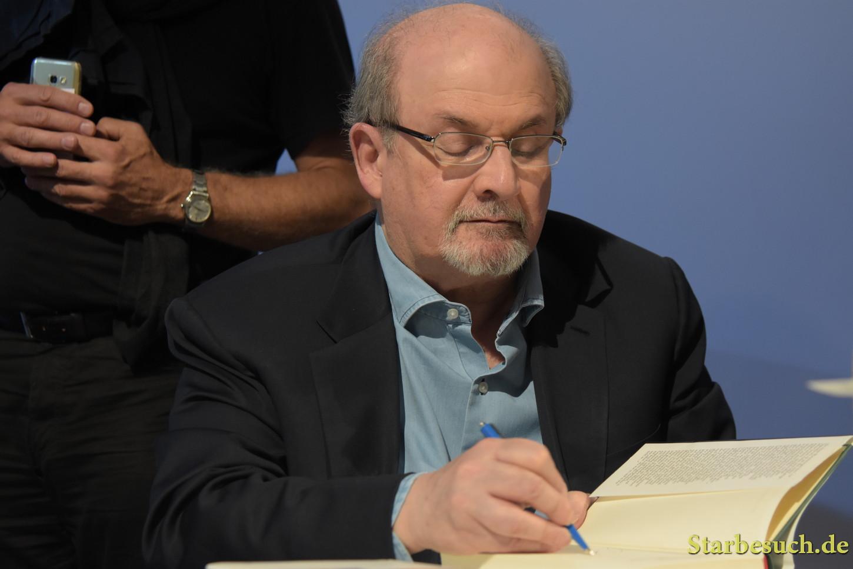 Salman Rushdie, novelist, signing copies of 'The Golden House', Frankfurt Bookfair / Buchmesse Frankfurt 2017
