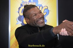 Dortmund, Germany - December 9th 2017: US Actor Christopher Judge (* 1964, Teal'c in the sci-fi tv series Stargate SG-1, Andromeda) greeting a fan at German Comic Con Dortmund.