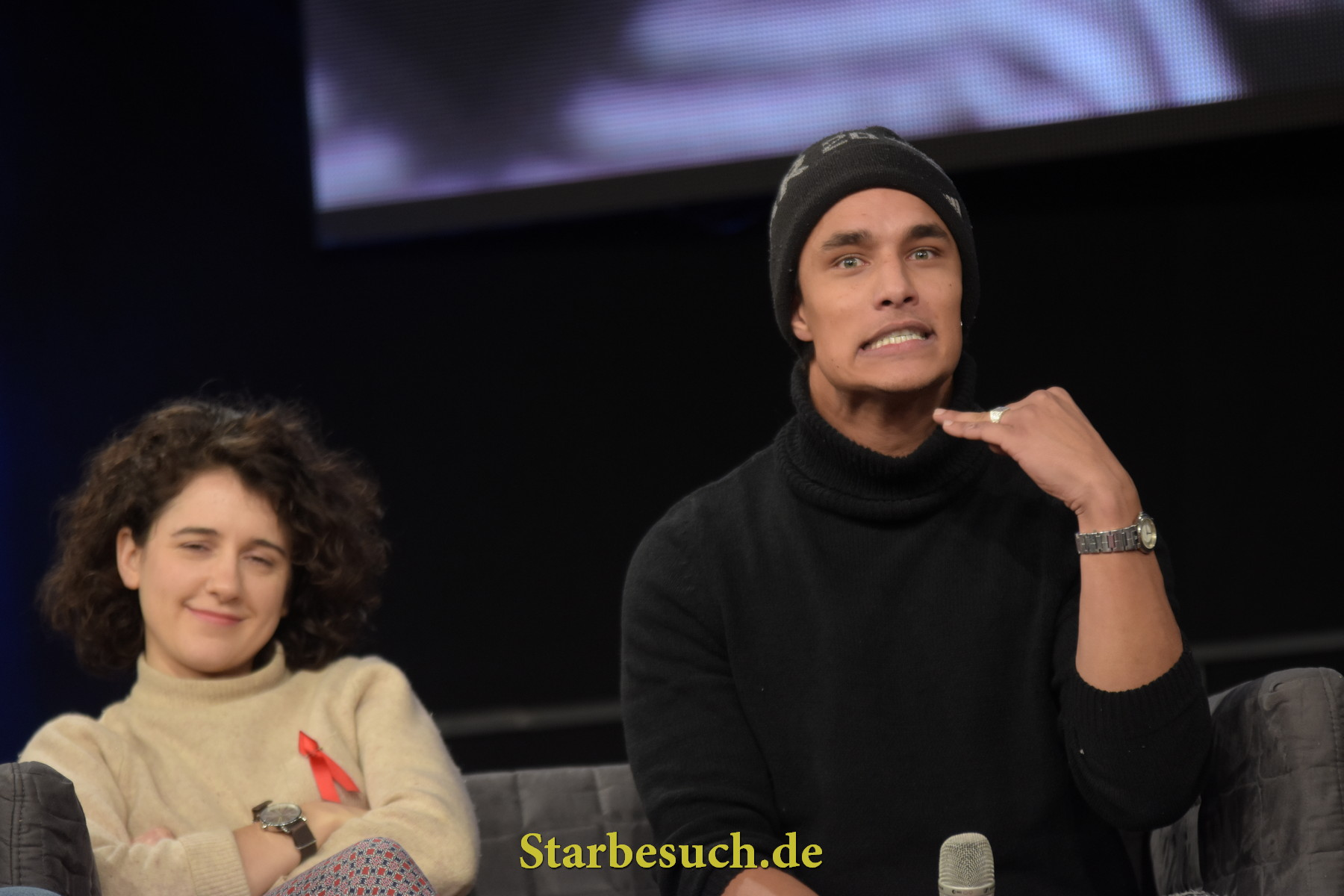 Dortmund, Germany - December 9th 2017: British Actor Staz Nair (* 1991, Qhono in the HBO fantasy series Game of Thrones) signaling: Don't ask about Season 8! At Game of Thrones panel, German Comic Con Dortmund