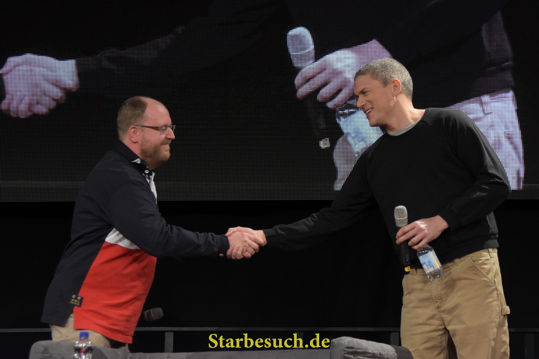 Dortmund, Germany - December 9th 2017: Gerrit Schmidt-Foß, german actor and voice actor (german voice Wentworth Miller), welcoming Wentworth Miller at German Comic Con Dortmund.