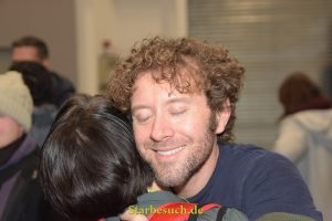 Dortmund, Germany - December 9th 2017: US Actor TJ Thyne (* 1975,  Dr. Jack Hodgins in the tv series Bones) hugging a fan at German Comic Con Dortmund.