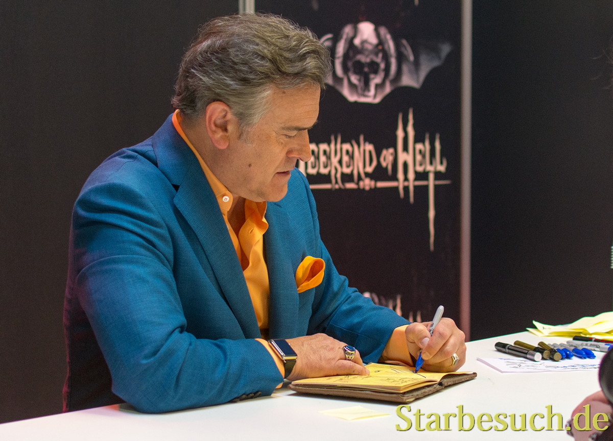 DORTMUND, GERMANY - APRIL 8: Actor Bruce Campbell (Ash vs Evil Dead, Evil Dead) signing autographs at Weekend of Hell, a two day (April 7-8 2018) horror-themed fan convention.