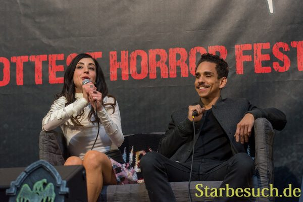 DORTMUND, GERMANY - APRIL 8: (L to R) Actors Dana DeLorenzo & Ray Santiago (Ash vs Evil Dead), at Weekend of Hell, a two day (April 7-8 2018) horror-themed fan convention.