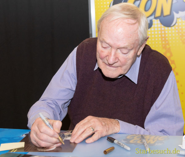 DORTMUND, GERMANY - December 1st 2018: Julian Glover (*1935, English actor) signing autographs for fans at German Comic Con Dortmund, a two day fan convention