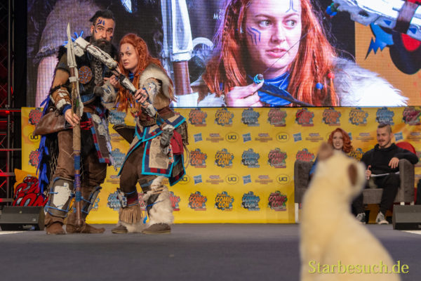 DORTMUND, GERMANY - December 1st 2018: Cosplayers Demateraliz + Naevarin portray the characters Rust+Aloy from Horizon Zero Dawn (Game) at German Comic Con Dortmund, a two day fan convention