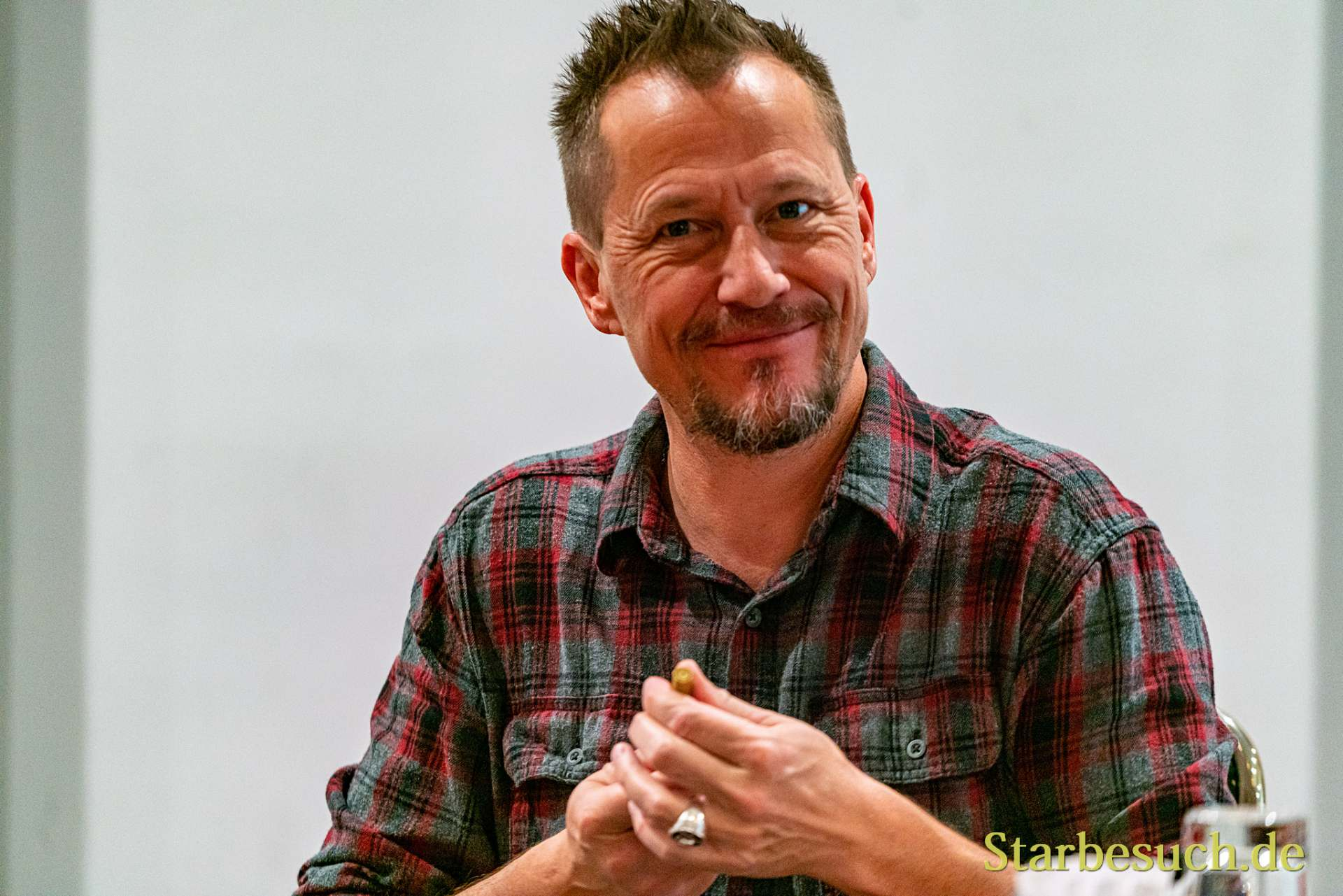 Bonn, Germany - June 8 2019: Corin Nemec (*1971, American actor - Stargate SG-1) signing autographs for fans at FedCon 28, a four day sci-fi convention. FedCon 28 took place Jun 7-10 2019.