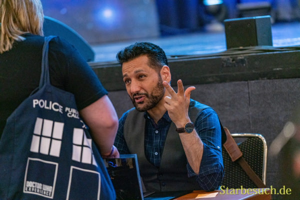 Bonn, Germany - June 8 2019: Cas Anvar (Canadian actor - The Expanse) is happy to meet fans at FedCon 28, a four day sci-fi convention. FedCon 28 took place Jun 7-10 2019.