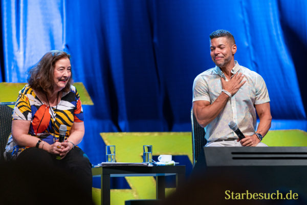 Bonn, Germany - June 8 2019: Wilson Cruz and Lori Dungey speaking at FedCon 28, a four day sci-fi convention. FedCon 28 took place Jun 7-10 2019.