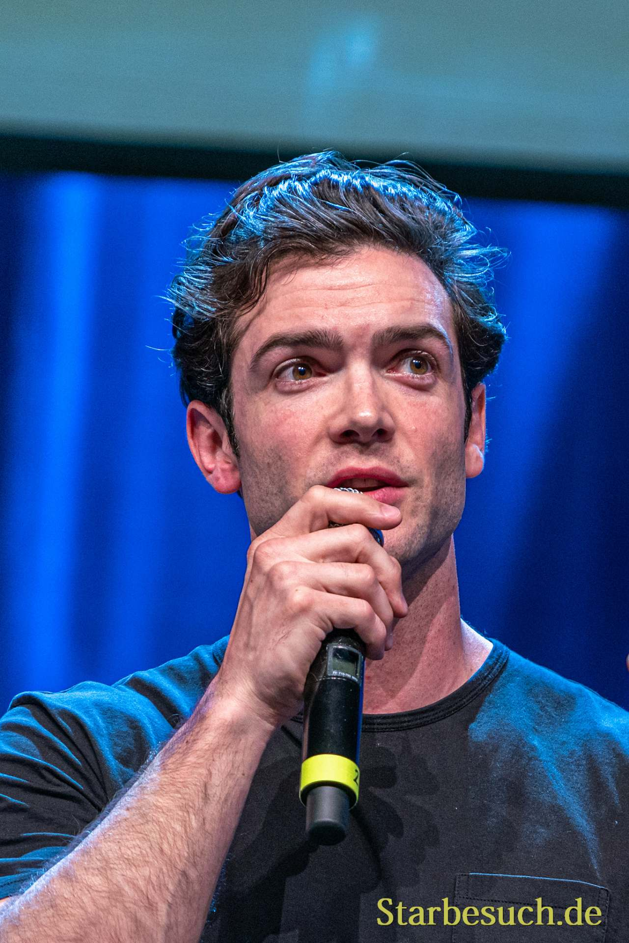 Bonn, Germany - June 8 2019: Ethan Peck (*1986, American actor -  Star Trek: Discovery) talks about his experiences in Star Trek Discovery at FedCon 28