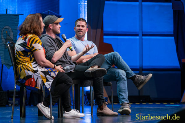 Bonn, Germany - June 8 2019: Aaron Ashmore, Luke Macfarlane and Lori Dungey talk about their experiences in the movie industry at FedCon 28