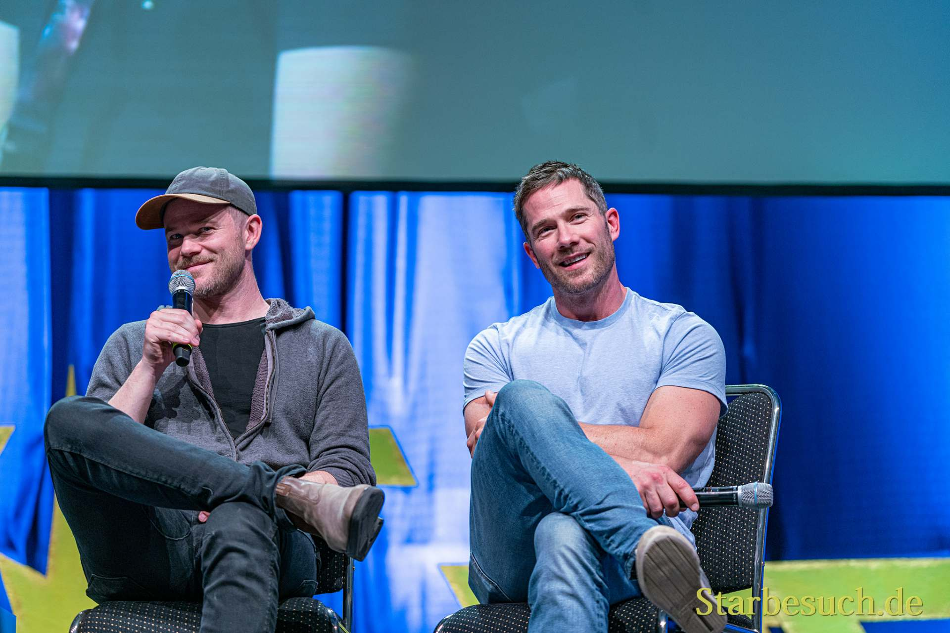 Bonn, Germany - June 8 2019: Luke Macfarlane and Aaron Ashmore talk about their experiences in Killjoys at FedCon 28, a four day sci-fi convention. FedCon 28 took place Jun 7-10 2019.