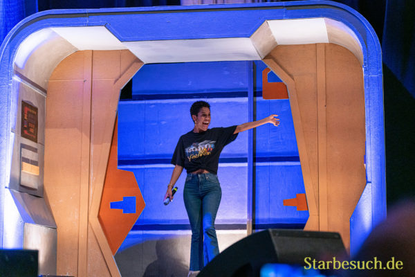 Bonn, Germany - June 8 2019: Dominique Tipper (*1987, British actress, singer-songwriter and dancer - The Expanse) entering the panel at FedCon 28