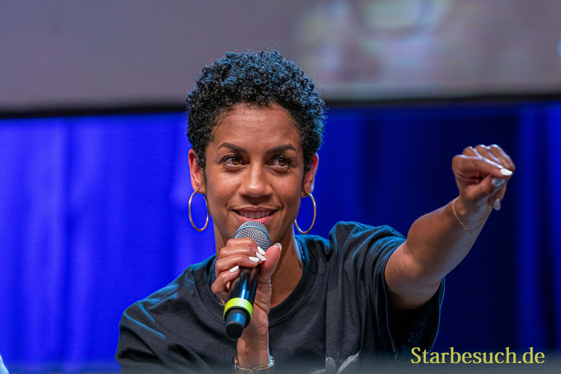 Bonn, Germany - June 8 2019: Dominique Tipper (*1987, British actress, singer-songwriter and dancer - The Expanse) talks about her experiences in The Expanse at FedCon 28