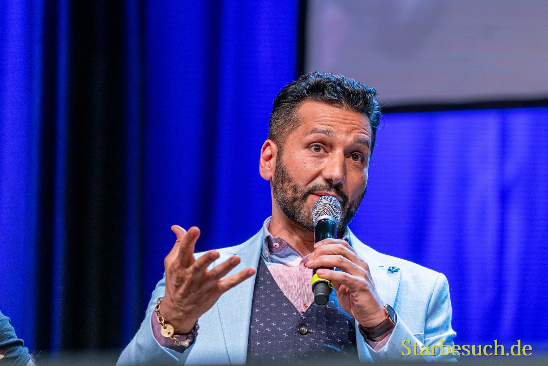 Bonn, Germany - June 8 2019: Cas Anvar (Canadian actor - The Expanse) talks about his experiences in The Expanse at FedCon 28, a four day sci-fi convention. FedCon 28 took place Jun 7-10 2019.