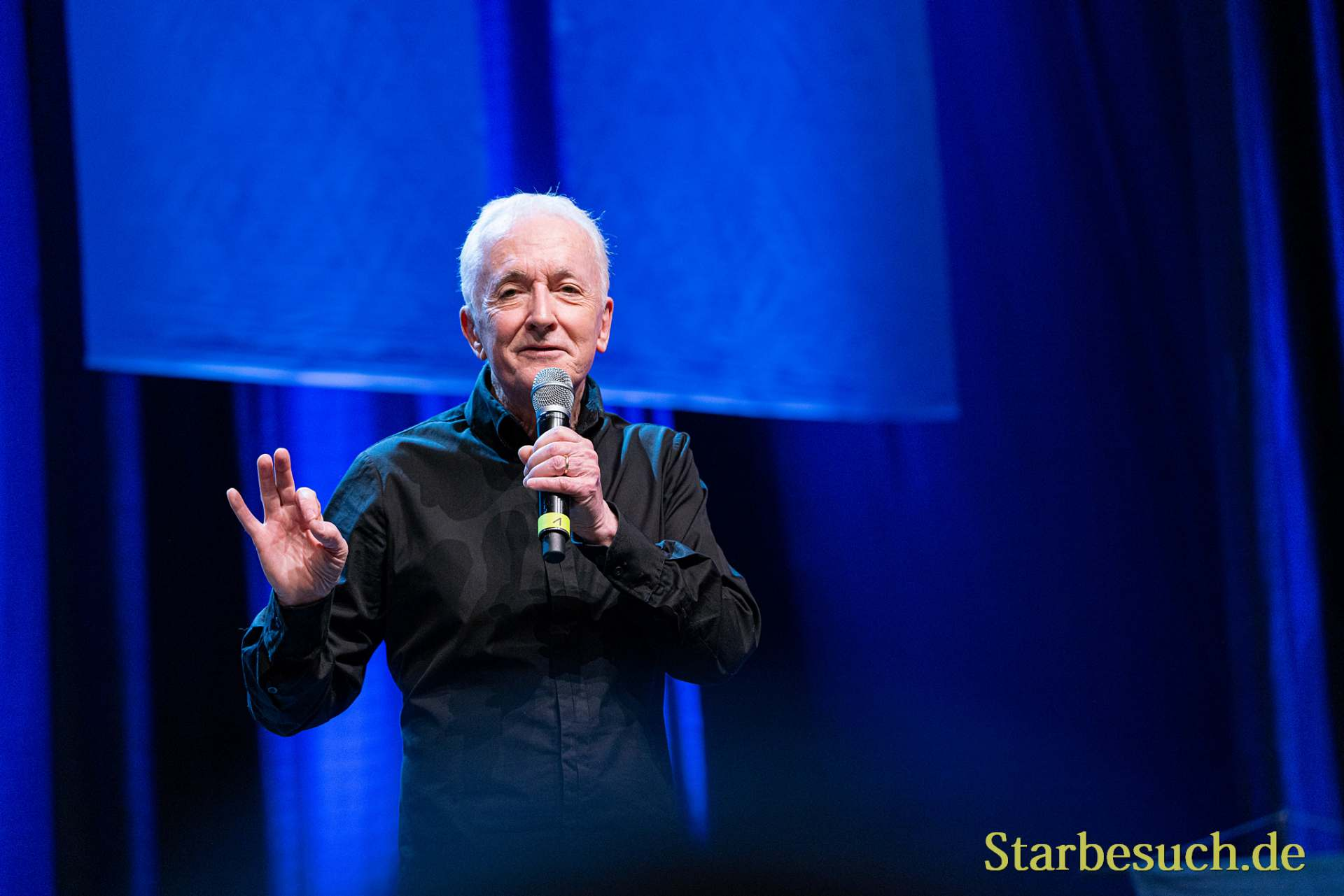 Bonn, Germany - June 8 2019: Anthony Daniels (*1946, English actor - C-3PO in Star Wars) talks about his experiences in Star Wars at FedCon 28