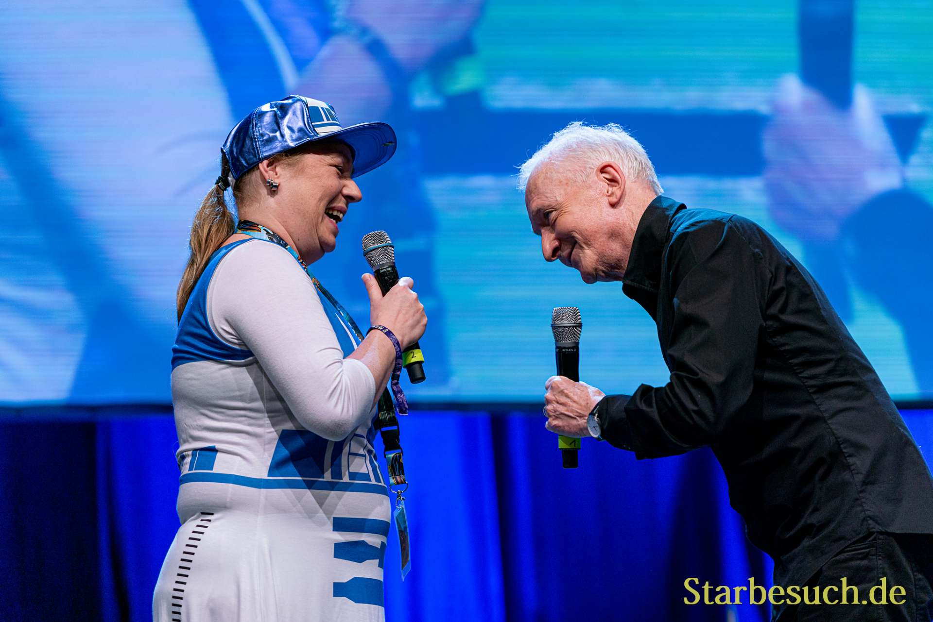 Bonn, Germany - June 8 2019: a fan and Anthony Daniels at FedCon 28, a four day sci-fi convention. FedCon 28 took place Jun 7-10 2019.