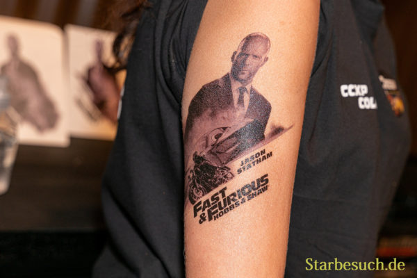 COLOGNE, GERMANY - JUN 28th 2019: Impressions from CCXP Cologne: Fast & Furious: Hobbs & Shaw tattoos at the convention