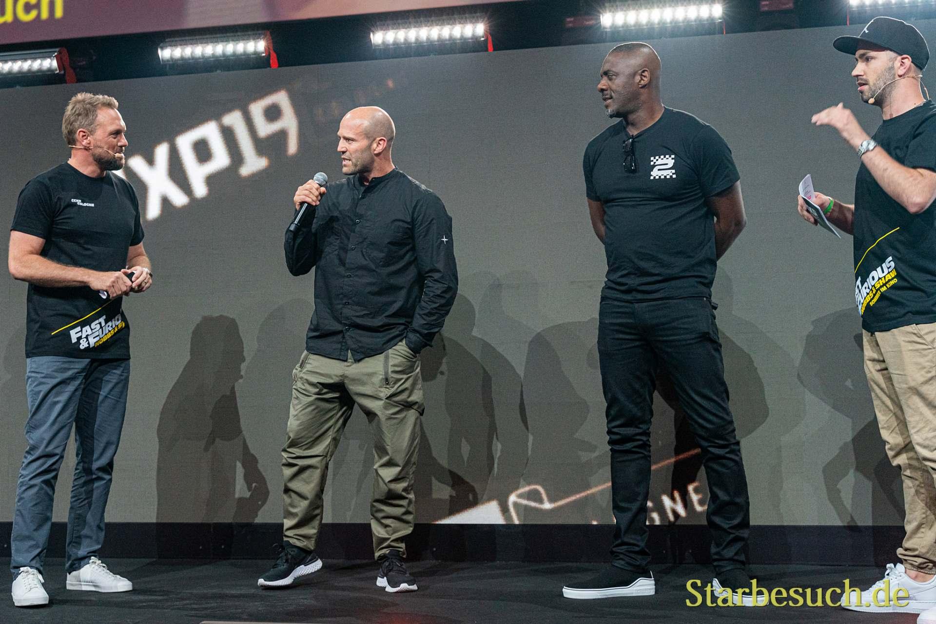 COLOGNE, GERMANY - JUN 28th 2019: Jason Statham, Idris Elba and Steven Gätjen at CCXP Cologne